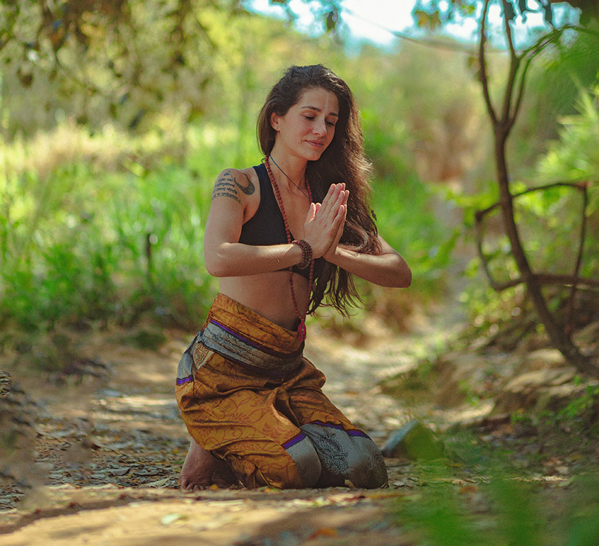 what-is-spirituality-woman-praying-in-the-forest